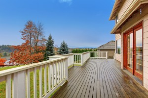 Beautiful large backyard with deck lots of grass annd a view.